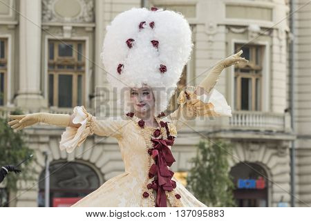Bucharest, Romania - June 10, 2016: Ladies dressed in Baroque style at B-FIT in the Street. B-FIT is a cultural event that involves international artists and acrobats who act in theater plays on street.