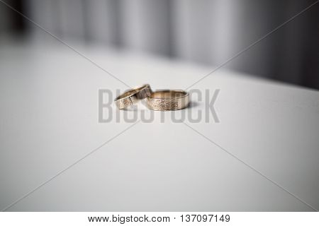 wedding rings on a white blurred background