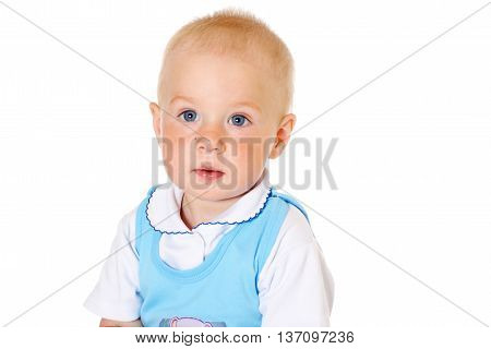 little cute baby boy looking at camera close-up portrait on white background