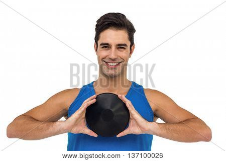Happy male athlete posing with discus throw on white background