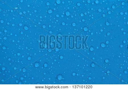 Rainproof tent sheet with rain drops.macro shot