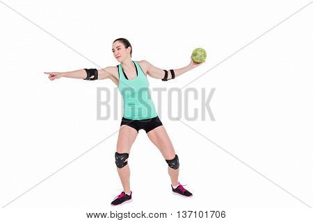 Female athlete with elbow pad throwing handball on white background