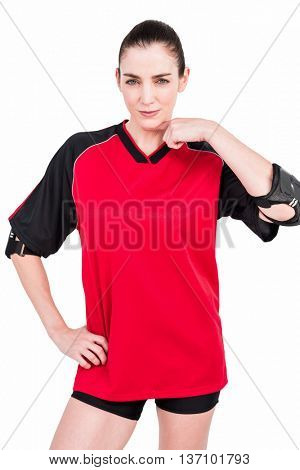 Female athlete posing with elbow pad on white background