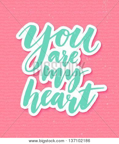 You are my heart. Romantic inspirational quote for valentines day cards, greetings, t-shits and wall art posters. Vector turquoise calligraphy on pink grunge background.