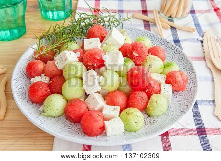 Cucumber salad with feta and water melon balls