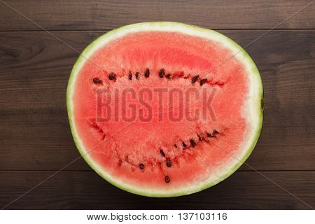 half of watermelon on the wooden table