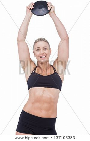 Female athlete holding discus on white background