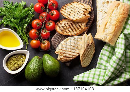 Ciabatta sandwich cooking ingredients over stone background. Top view