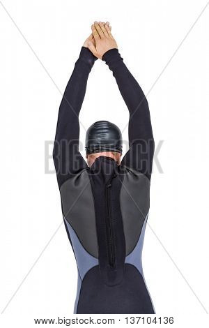 Rear view of swimmer in wetsuit while diving on white background