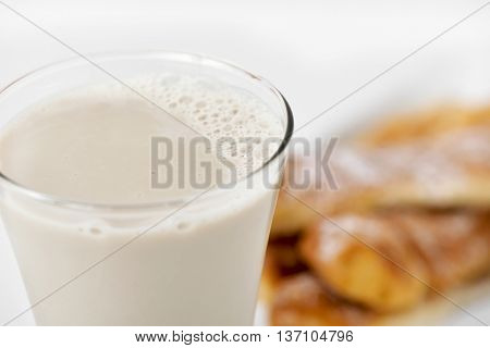 a glass with horchata and some fartons, a typical snack in Valencia, Spain