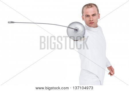 Portrait of swordsman practicing with fencing sword on white background