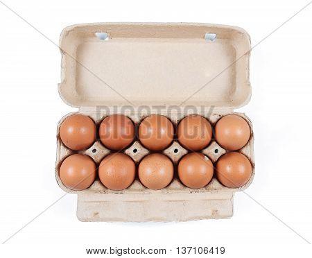 Open cardboard box with ten chicken eggs