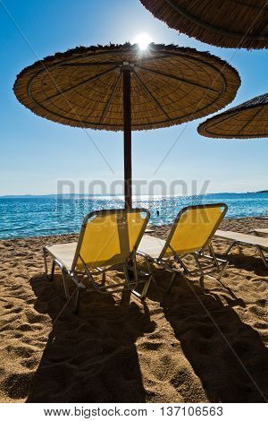 Straw parasols on a beach in Sithonia, Greece
