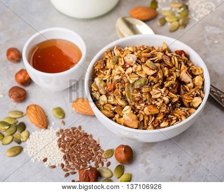 Delicious homemade nutty granola served with honey