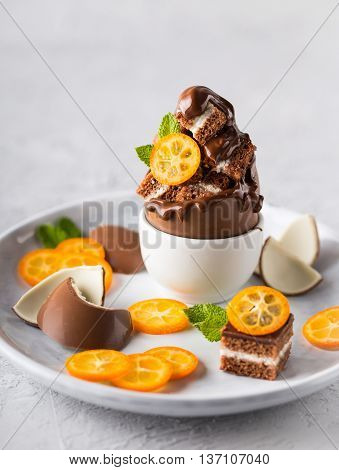 Brownies with melted milk chocolate and some kumquat slices