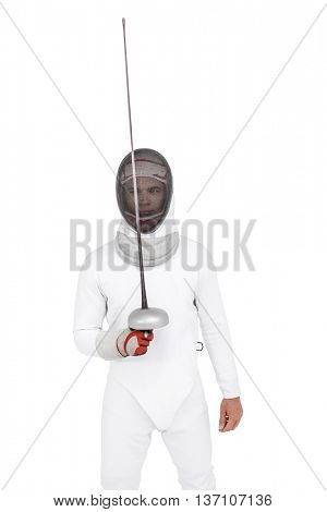 Man wearing fencing suit practicing with sword on white background