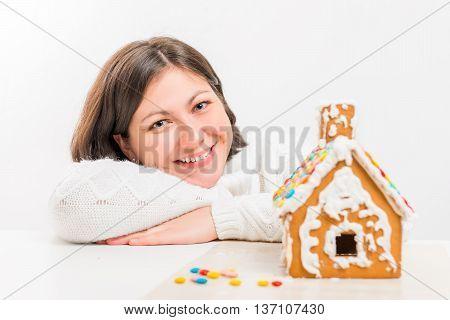 Portrait Of Happy Girl Near Gingerbread House
