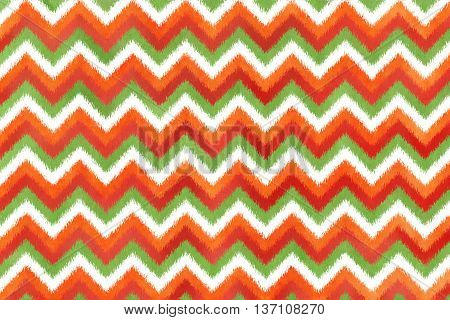 Ethnic Zigzag Pattern In Orange, Red And Green Colors.