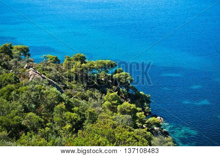 Greek mediterranean coast with beautiful blue tones of Aegean sea in Sithonia, Greece