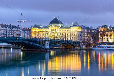 Lyon University bridge along Rhone river at night in Lyon France