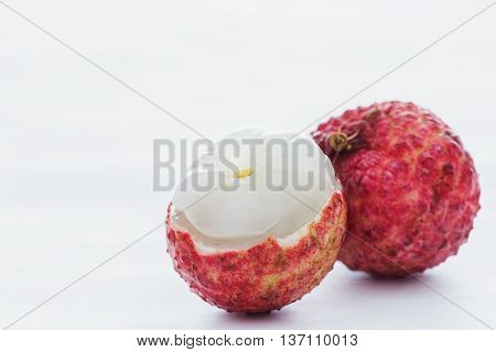 A fresh lychee on a white background.