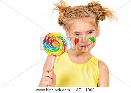 Cute little girl with painted colorful cheeks licking a lollipop. Happy childhood. Isolated over white.