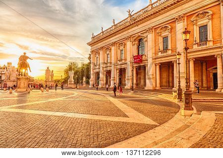 Rome, Italy - circa June 2016: People moving in the Campidoglio square on the Capitoline Hill, Mons Capitolinus, one of the seven hills of Rome. Designen by artist Michelangelo in Renaissance age