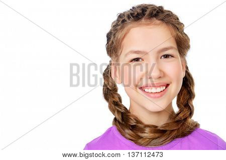 Cheerful teen girl in bright casual clothes with long braids. Hair, haircare. Studio shot. Isolated over white.