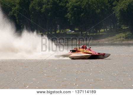 Madison Indiana - July 2 2016: Fred Shearer drives the GNH 17 7Th Edition hydroplane at the Madison Regatta in Madison Indiana July 2 2016.