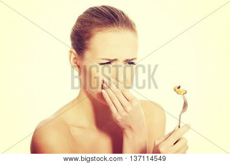 Woman eating seafood with disguise.