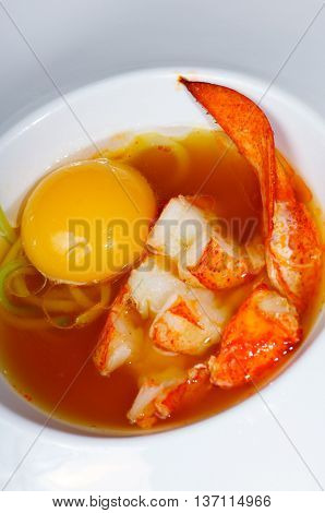Lobster with  egg yolk and sea  soup
