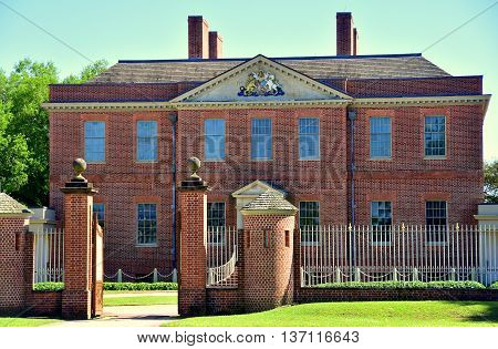 New Bern North Carolina - April 24 2016: Entrance gate round sentry booths and north front of 1770 Tryon Palace