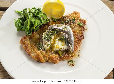 Escalope of veal Holstein with spinach, lemon & anchovies, buerre noisette