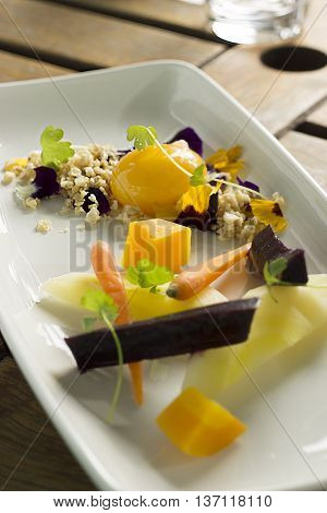 Heirloom carrots with confit egg yolk, hazelnut nasturtium crumble