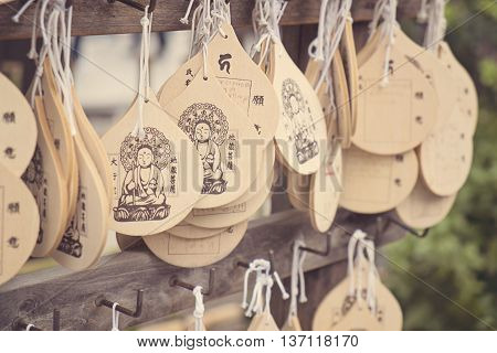 ASAKUSA, JAPAN - APRIL 24:The written wishes wooden plate of Senso-ji temple which dedicated from Tourist Organization of Japan and partners to the shrine on April 24, 2016 in Asakusa, Japan.