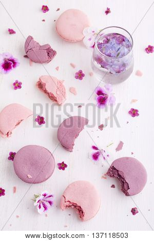 Macaroons bits and bites on a white painted board