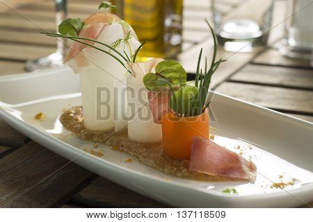Romesco with Serrano ham, radish & micro herbs