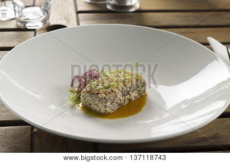 Sesame crusted tuna, ginger miso broth, seaweed