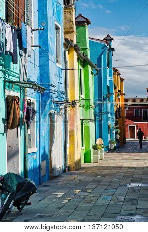 Architectural Exterior of Brightly Colored Row Houses on Sunny Day on Burano, Islands of Murano, Venice, Italy