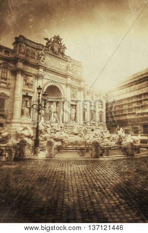 Toned vintage sepia image of the Trevi Fountain in Rome, one of the most famous Baroque fountains in the world and an iconic Roman cultural landmark