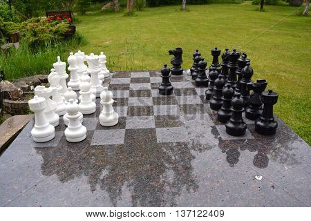 chess and chessboard in ranch yard on table