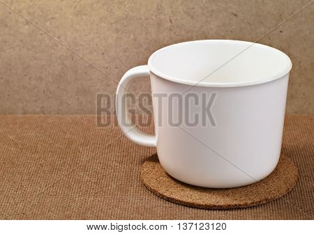 White plastic cup on wooden serving tray