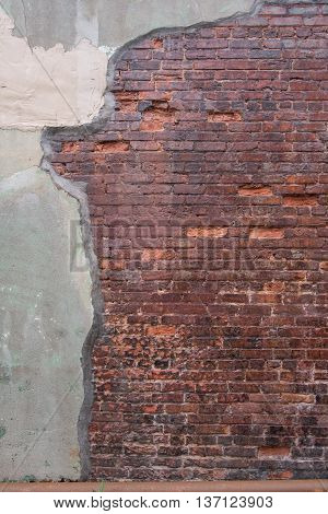 Antique Red Brick Wall with Grout Skim on Left vertical image