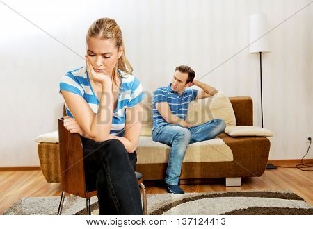 Sad couple not talking after fight