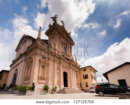 BRUNATE, ITALY - MAY 2016: St. Andrew the Apostle Church is a sacred building site in Brunate, in the province of Como. Scenic arhitectural background. Europe.