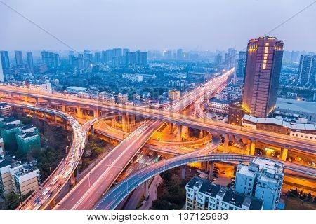 city highway overpass in hangzhou bright lights and traffic.
