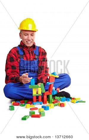 Construction Worker Playing With Wood Blocks