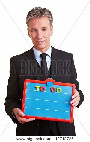 Business Man Holding A To Do List