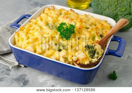 Casserole with pasta chicken broccoli and Bechamel sauce under a cheese crust