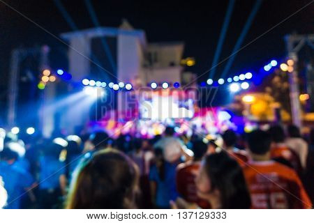 Blurred Image Of Concert Crowd In Front Of Bright Stage Lights